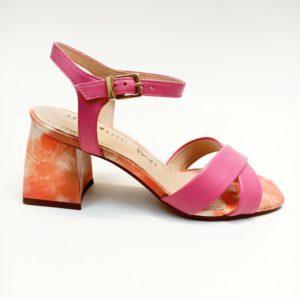 Strappy hot pink sandal on a block heel, with orange floral heel.