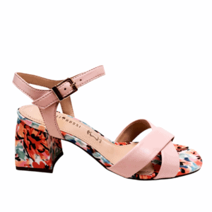 pastel pink strappy sandal with a buckle strap at the ankle, Sitting on a bright floral sole unit.