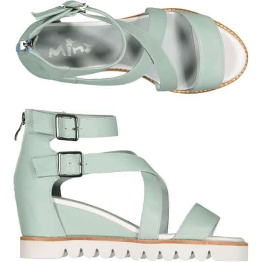 a lovely light green mint leather sandal - ankle strap with buckles. Sitting on a wedge sole unit.