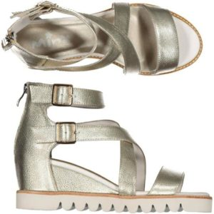 a soft gold leather strappy sandal sitting on a wedge sole unit